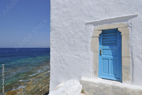Blue Door by the sea Mykonos Greece