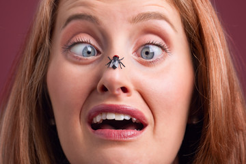 Woman with a fly on her nose