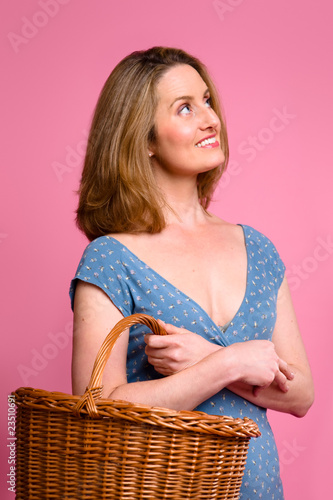 Woman carrying wicker shopping basket