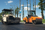 Asphalt pavement machinery at work poster