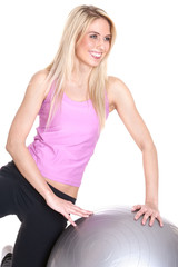 Fit mature woman holding a fitness ball