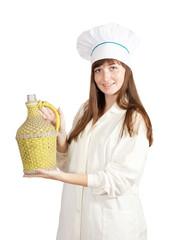 cook holding large bottle
