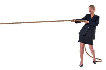 Blond businesswoman pulling on rope