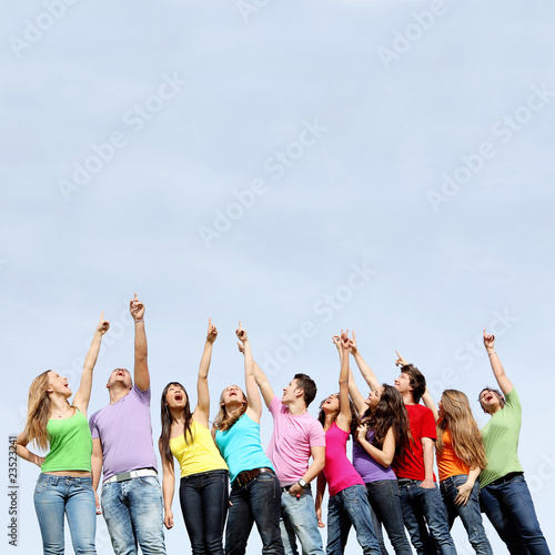 group teens pointing up at summer camp
