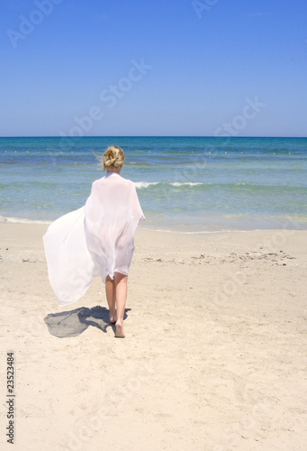 woman on the beach with a white sarong