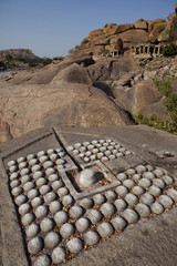 Carved linga in the bank of the Tungabhadra River, Hampi