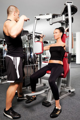 Female gym exercise trainer