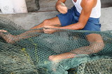 Fisherman  Mending Fishing Net