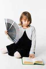 Pretty girl with fan and book