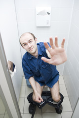 Scared man in toilet
