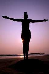 Sunset silhouette yoga/freedom pose.