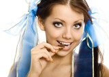 pigtails girl with chocolate enjoy closeup isolated poster
