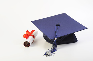 cap and diploma isolated on white