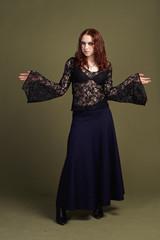Goth girl in long dark dress stay