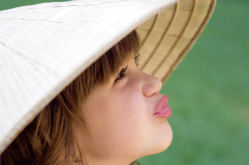Young girl in the Vietnamese hat