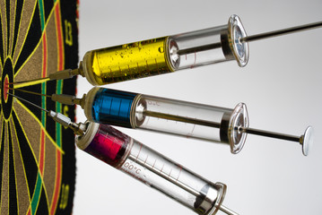 Syringes with colourful liquids hits the target