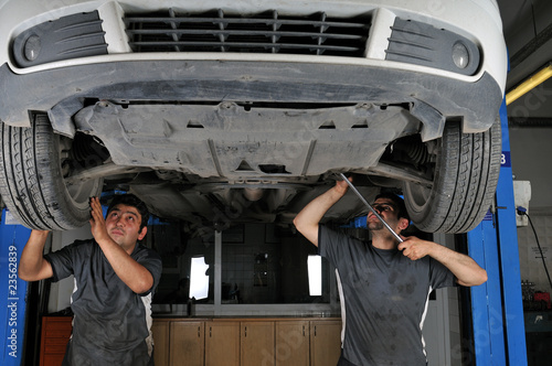 Auto mechanics working under the car - a series of MECHANIC