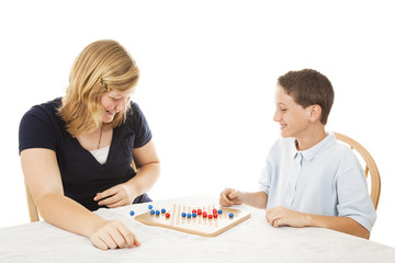 Siblings Play Board Game