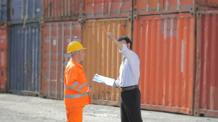 Manual worker, businessman and cargo containers