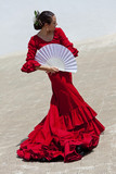 Fototapety Spanish Flamenco Dancer In Red Dress With Fan