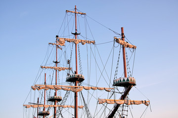 Masts against blue sky.