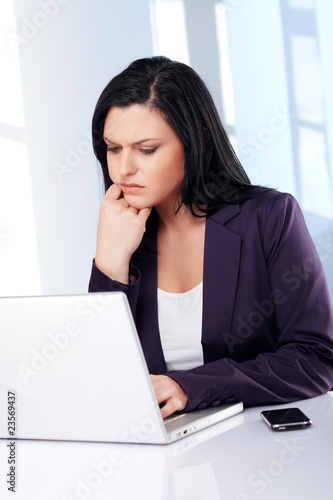 Business woman with laptop, perplex