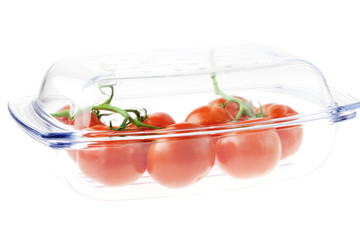 tomatoes in a glass isolated on white