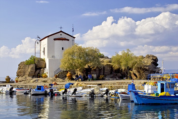 Chapel on rocks in the port of Skala Sykamineas