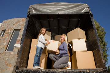 Mother and daughter in the back of a truck