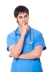 pensive doctor in blue uniform