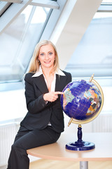 pointing on the globe