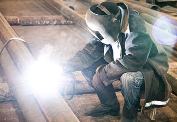 Welder in mask