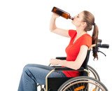 young sad alcoholic woman on the wheelchair
