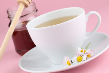 Herbal tea with primroses and honey