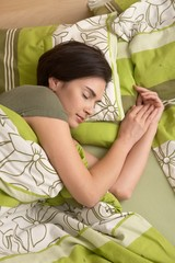 Woman smiling in sleep