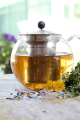 Herbal tea in teapot on the table