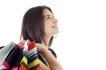 Smiling Woman with Shopping Bags Looking at Copyspace
