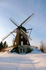 Old windmill in winter setting