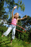 Little girl having fun with hula hoop