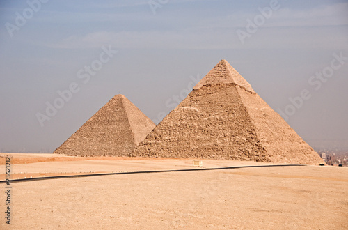 Ancient Egyptian pyramid of Giza against blue sky
