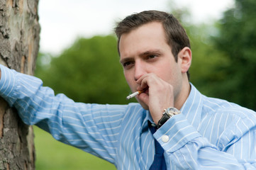 Young businessman smoking