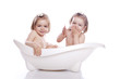 children in white bath tub