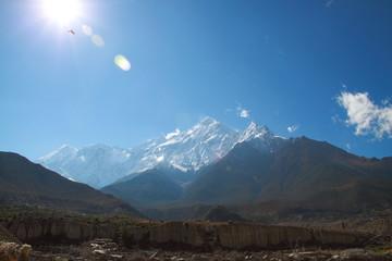 Himalaya and Sun Light and Blue Sky and a Bird
