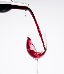 Pouring Red Wine with beautiful drops