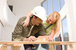 Couple doing home decoration