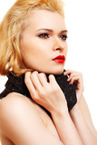Beautiful woman with blond hair, red lips and black scarf