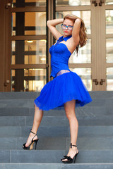 sexy woman in blue fashion dress