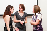 Three business women talking togther in office room