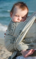 close up portrait of baby on sea background