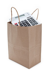 Brown paper shopping bag and calculator